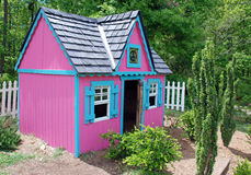 Peace and Love House. A cute play house painted pink and blue for kids who are into a hippie lifestyle.  This well maintained doll house has a peace sign in the Stock Image