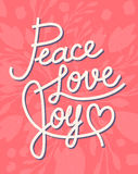 Peace, love, joy Christmas lettering quote on pink Royalty Free Stock Images