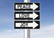 Peace, Love and Joy. Conceptual one way street signs with a Christmas concept Stock Photos