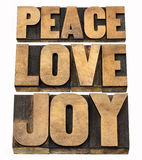 Peace, love and joy in wood type Royalty Free Stock Images