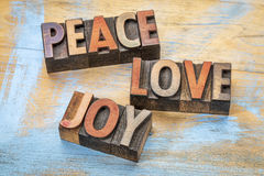 Peace, love and joy in wood type Stock Photos