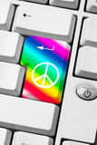 Peace and love message. Keyboard with peace and love symbol on rainbow background - web communication of pacifist message Royalty Free Stock Photography