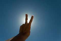 Peace and love sign. V for victory sign against the sun Stock Images