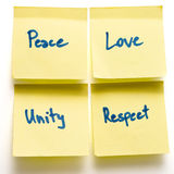Peace love unity respect yellow post-its on board. Peace love unity respect yellow post-its on a board isolated royalty free stock image