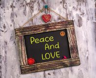 Peace and love written on Vintage sign board royalty free stock images