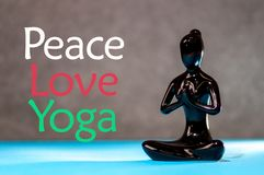 Peace Love Yoga concept. Meditation healthy female figurine in peace, soul and mind zen balance concept.  Royalty Free Stock Photo