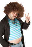 Peace man. Old hippie with beerbelly holding up his fingers in peace sign Royalty Free Stock Images