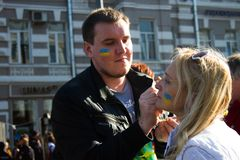 Peace March, participants draw on their faces, Ukrainian flag Stock Image