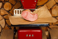 Peace of meat on red scales Stock Photos
