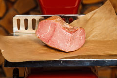 Peace of meat on red scales Royalty Free Stock Photo