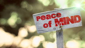 Peace of Mind. Written on a piece of wood and nice blurred background Royalty Free Stock Photography