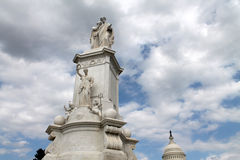 Peace monument, capitol and puffy clouds Royalty Free Stock Images