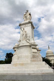 Peace monument, capitol and puffy clouds Stock Image