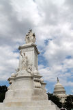 Peace monument, capitol and puffy clouds Stock Photos