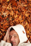 At Peace with Nature. Or at one with nature - man sleeping on some fallen leaves royalty free stock images