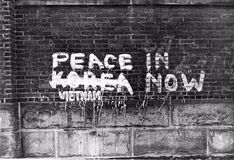 Peace now. Painted on a wall royalty free stock images