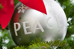 Peace ornament on a Christmas tree Stock Images