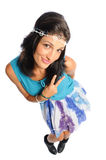 Peace out woman. Hispanic woman dressed as a hippie on a white background Royalty Free Stock Image