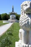 Peace pagoda milton keynes england. Lion statue in front of peace pagoda in willen park milton keynes buckinghamshire england Royalty Free Stock Photo