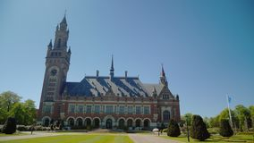 Hague,Netherlands, May 2018: The Peace Palace in The Hague, where the seat of the International Court of Justice is. The Peace Palace in The Hague, where the stock video footage