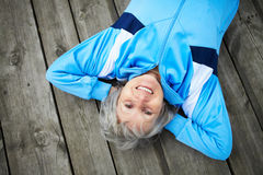 Peace and pleasure. Happy mature woman having rest outside Royalty Free Stock Photos