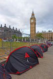Peace protesters near the Big Ben. Peace protesters living in a ramshackle camp next to the Big Ben on May 12, 2011 in London, UK. They support a range of causes Stock Image