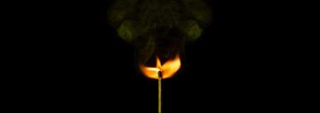 Peace purity life religion symbolic background with burning match stick. Match stick with smock and flame isolated on black background with copy space peace stock photography