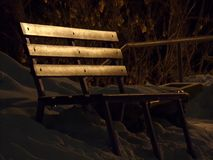 Park bench at night royalty free stock images