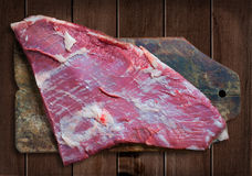 Peace of raw meat on wooden table. Stock Photography