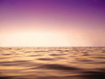 Peace sea and purple sky in sun set time close up as background Royalty Free Stock Image