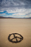 Peace shape made with stones Stock Images