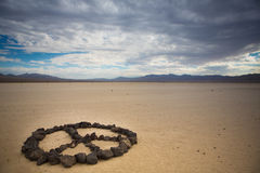 Peace shape made with stones Royalty Free Stock Photo