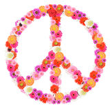 Peace sign. Made of beautifiul, colorful flowers on white background royalty free stock photo