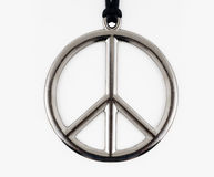 Peace sign. Necklace set against white background stock photo