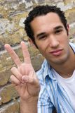 Peace Sign. Man giving Peace Sign royalty free stock photos