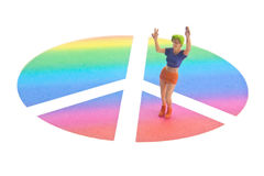 Peace Sign. Miniature female figure with rainbow peace sign Royalty Free Stock Photos