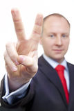 Peace sign by businessman Royalty Free Stock Images