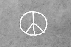 Peace sign drawing on gray concrete wall Stock Image