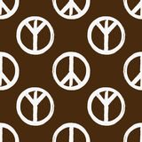 Peace sign drawn with a brush. Seamless pattern. Grunge ornament. Royalty Free Stock Images