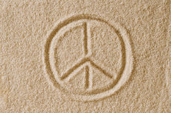 Peace Sign drawn in sand macro photo Royalty Free Stock Photography