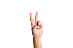 Peace sign. Female hand making a peace sign royalty free stock photos