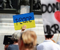 Peace sign on flag of Ukraine. Stock Photo