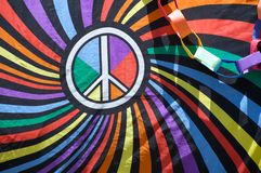 Peace sign on gay flag. Close-up of a flag with the peace sign during the Long Beach Lesbian and Gay Pride Parade 2012 royalty free stock image