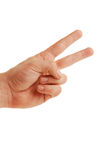 Peace sign isolated. Male hand making the peace sign/two fingers up, isolated on white background royalty free stock photo