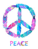 Peace sign made of colored bird feathers. Hippie symbol. Sixties Royalty Free Stock Image