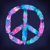 Peace sign made of colored bird feathers. Hippie symbol. Sixties Royalty Free Stock Photo
