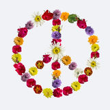 Peace sign made of fresh flowers. Stock Photo