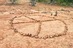 Peace. A peace sign made out of rocks Royalty Free Stock Images