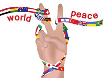 Peace sign. Ribbon with world flags wrapped around hand peace sign with text 'world peace royalty free stock photo