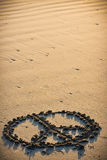 Peace Sign in the Sand Stock Photo